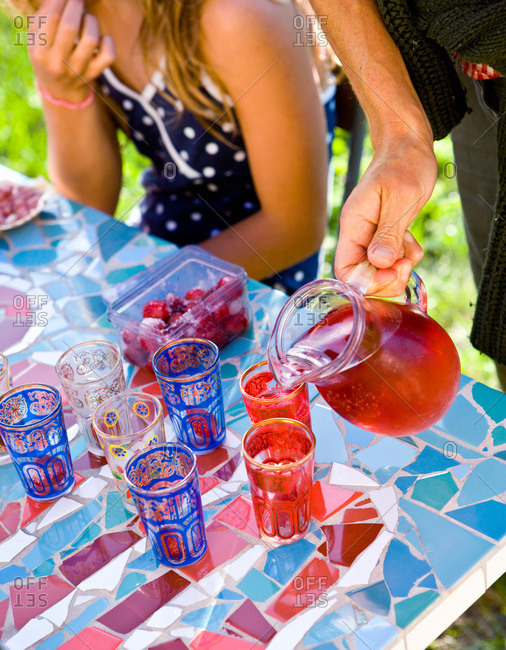 Person serving soft drinks at a children's party, Oland, Sweden