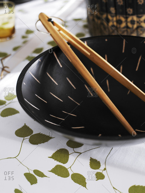 Chopsticks and a bowl set on table, close-up