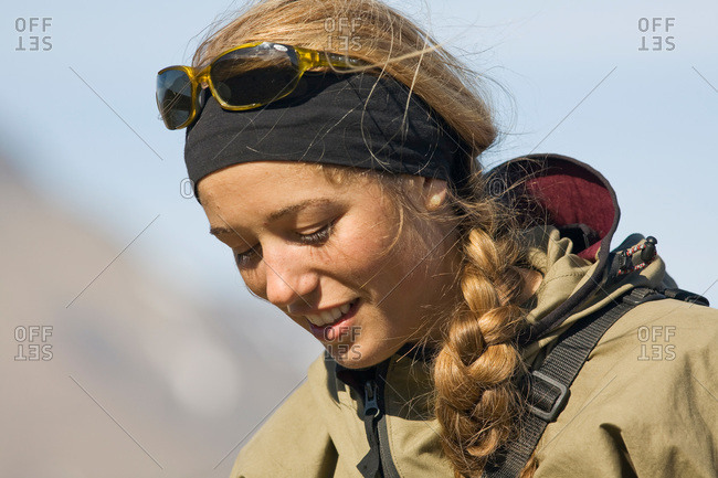 A young woman on a hiking tour in the mountains, Svalbard, Norway