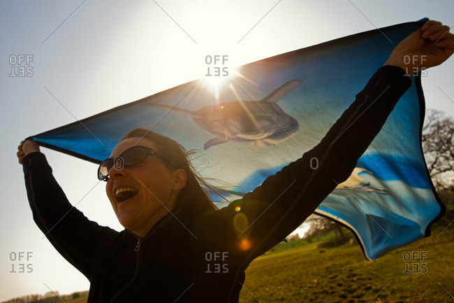 A woman holding a cloth in the wind, Sweden