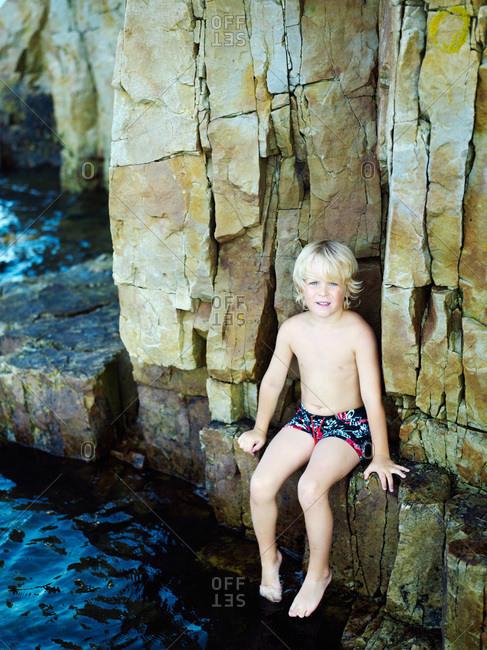 A happy Scandinavian boy by the sea, Sweden