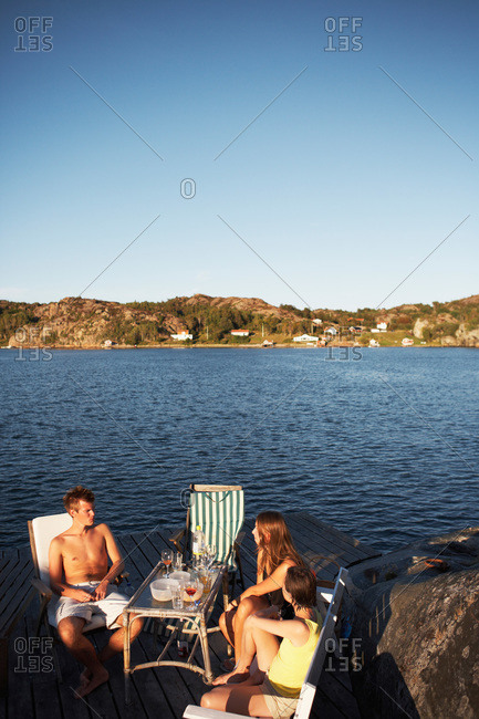 People sitting by the sea, Sweden