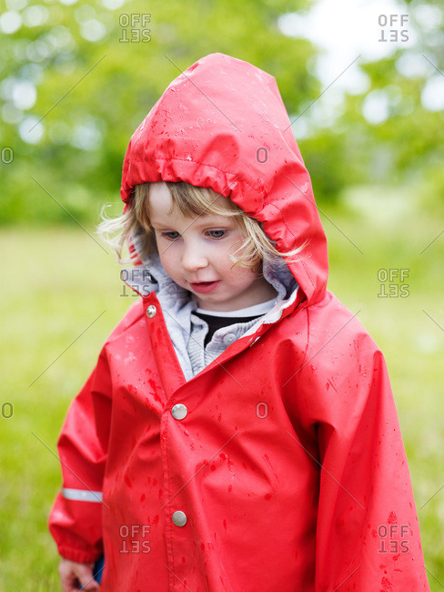A girl in a red raincoat