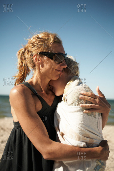 Mother and son embracing