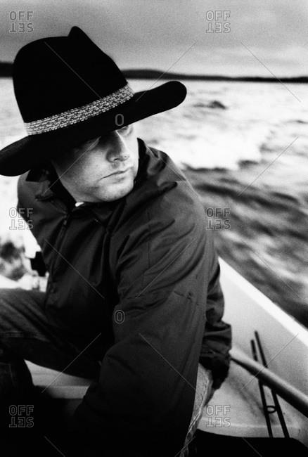 A man driving a boat, Dalarna, Sweden