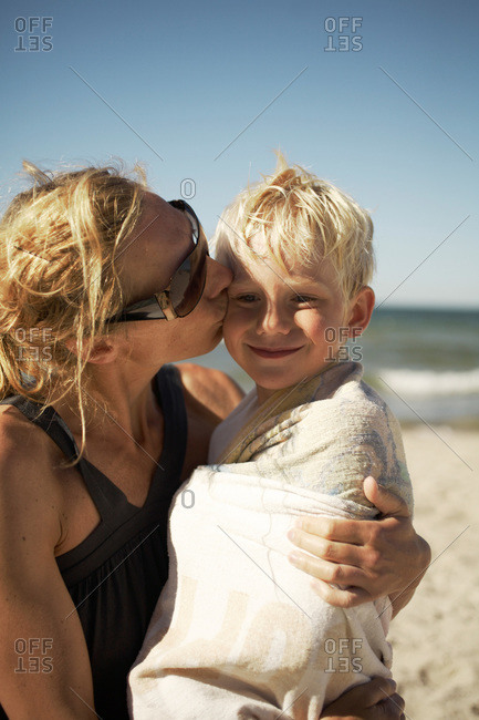 Mother kissing her son