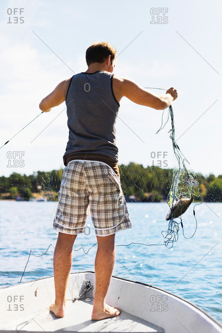 A man with a fishing-net