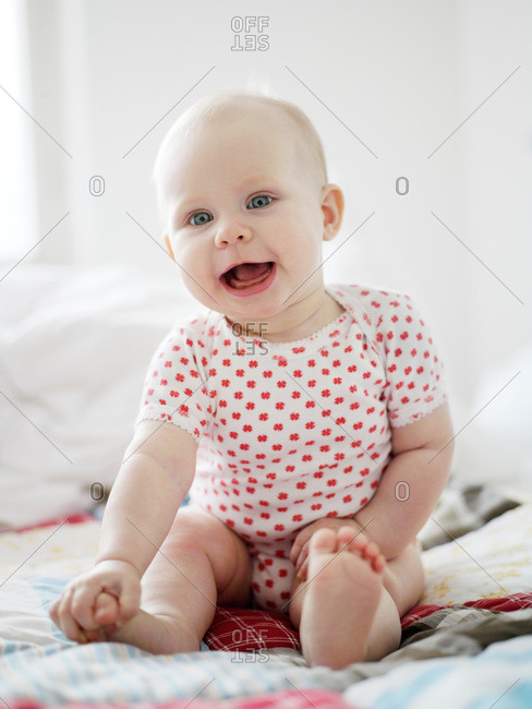 A baby girl laughing