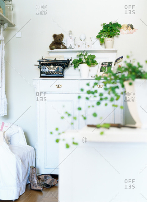 A chest of drawers with antique items