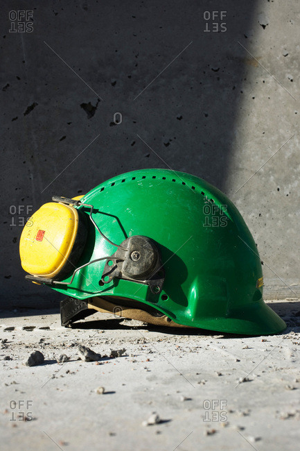 A green helmet with a hearing protector, Sweden