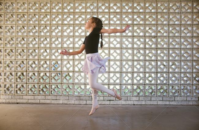 Girl doing ballet jump