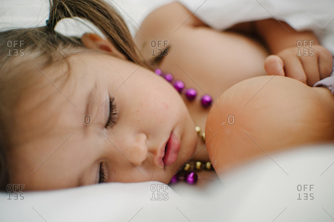 Girl in pigtails fast asleep
