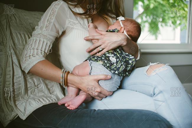 Woman in chair breastfeeding