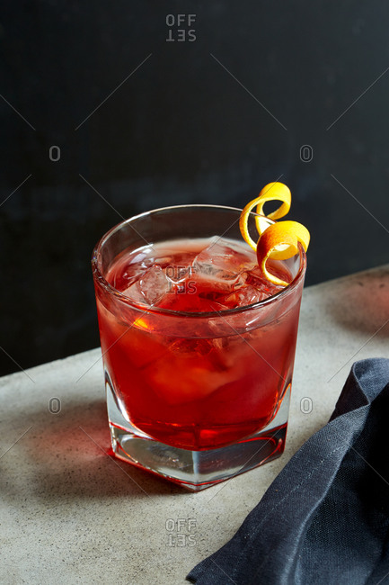 Red Boulevardier cocktail on a table