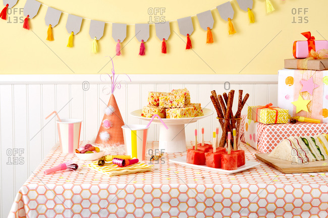 A room decorated for a birthday party filled with gifts and food