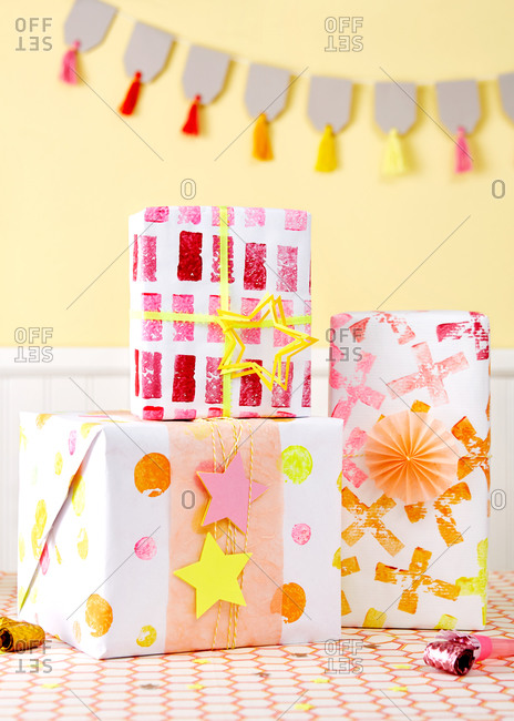 Gifts wrapped in potato stamped wrapping paper at a birthday party