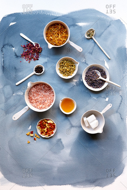 Overhead view of soap making ingredients on a watercolor background
