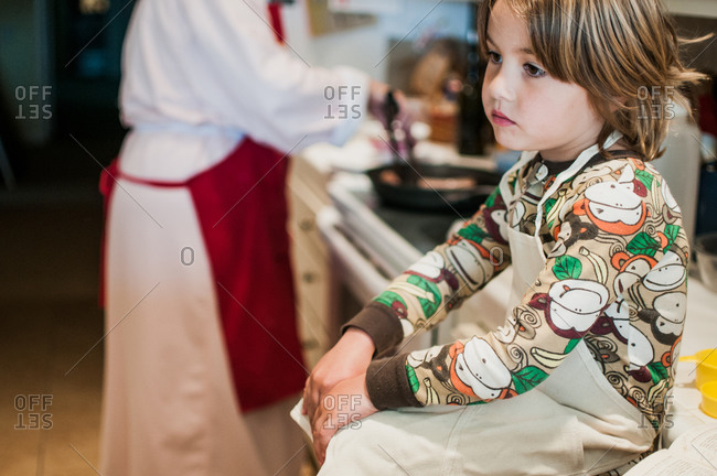 Little boy sitting on a kitchen counter
