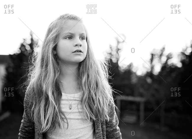 Portrait of a young girl looking away