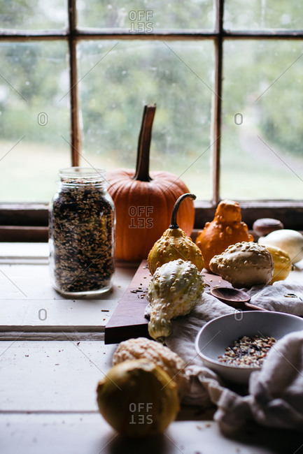 Pumpkin, gourds and a mason jar of wild rice