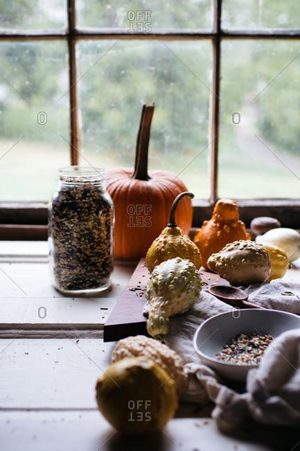 Pumpkin, gourds and a mason jar of wild rice