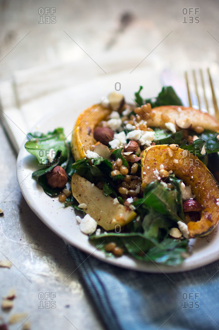 Winter squash salad with kale, nuts and feta
