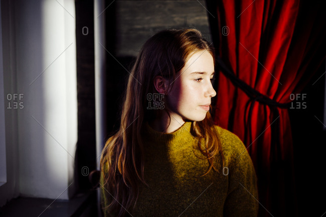 Portrait of girl in a yellow sweater