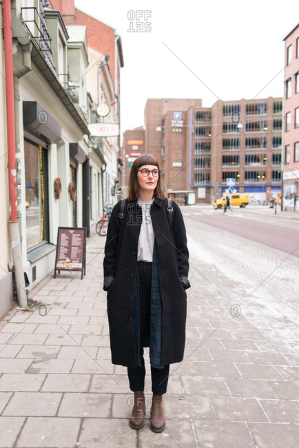 Hip young woman in long jacket