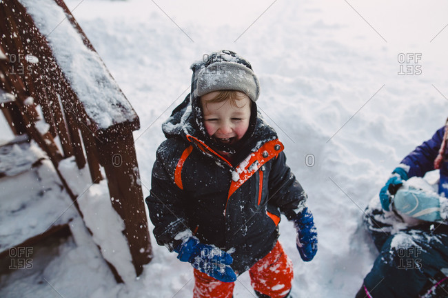 Children playing outside in the snow