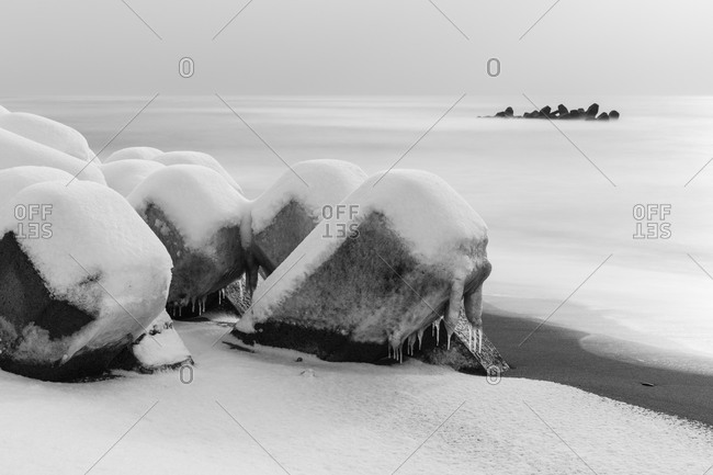 Snow and ice covered tetrapods along the East Sea shoreline in Hokkaido Japan