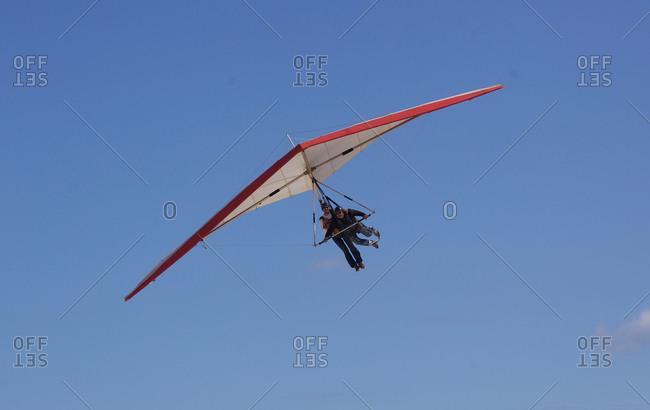 Rio De Janeiro, Brazil - September 9, 2010: A hang glider with passenger landing at Sao Conrado beach, Rio De Janeiro, Brazil