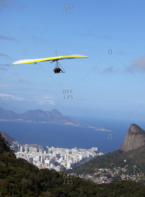 Rio De Janeiro, Brazil - September 9, 2010: A tandem hang glider flying above the city of Rio De Janeiro, Brazil