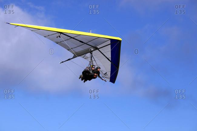 Rio De Janeiro, Brazil - September 9, 2010: A tandem hang glider flying up in the sky above Pedro Bonita, Rio De Janeiro, Brazil
