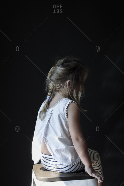 Portrait of a little girl from behind