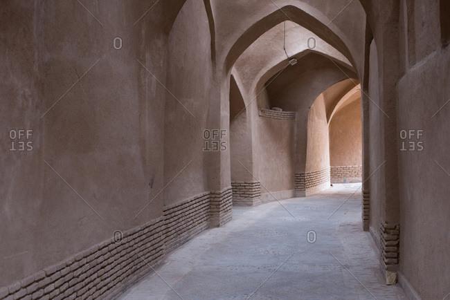 Passage between historic buildings in Yazd, Iran