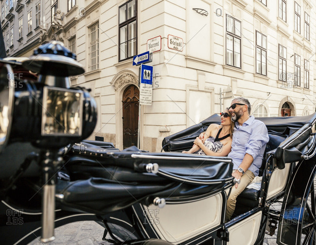Couple in love on sightseeing tour in a fiaker, Vienna