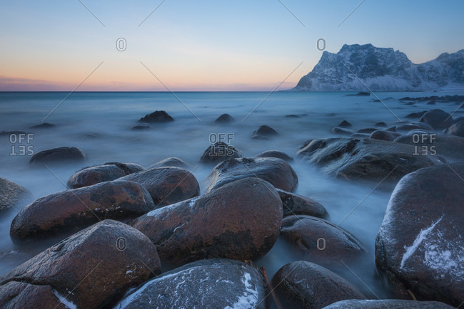 Utakleiv beach at sunrise in winter, Lofoten Islands, Norway