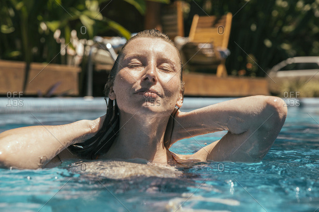 Portrait of relaxed woman in a swimming pool, Porto Seguro