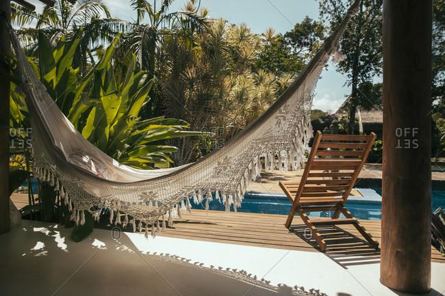 Porch of Bali style apartment hotel with hammock and swimming pool, Porto Seguro