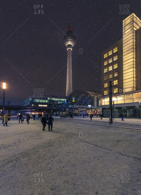Berlin, Germany - January 6, 2016: View to television tower at snow fall in the evening, Berlin