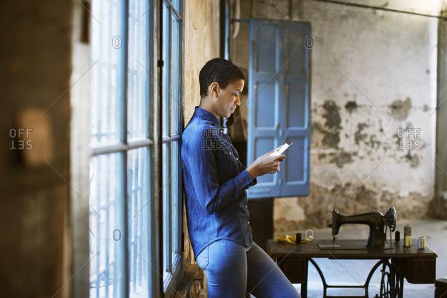 Fashion designer using cell phone on a break
