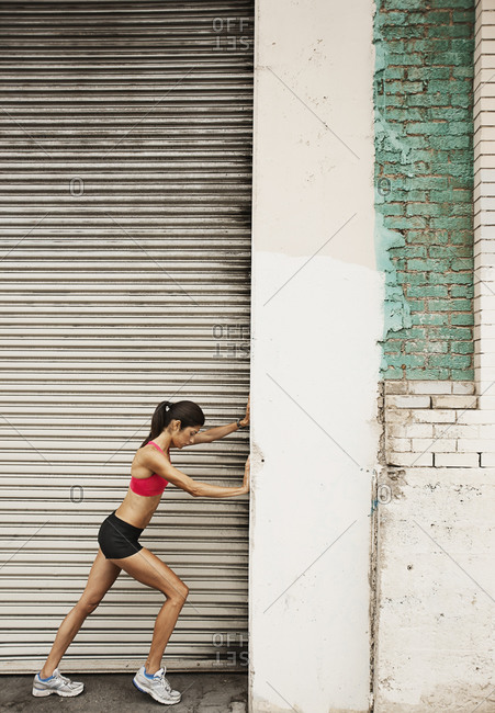Close up of a woman in running gear stretching before a run