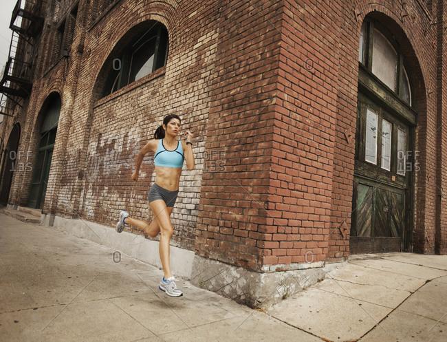 A woman jogging along an urban street