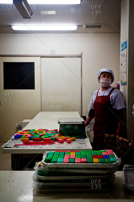 A cook prepares colored sweets in a restaurant kitchen in Kanazawa, Japan