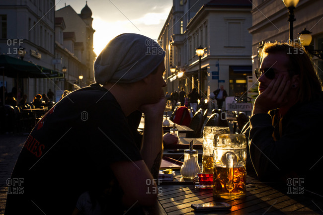 Tourists drinking beer outside in the evening light in Potsdam, Germany