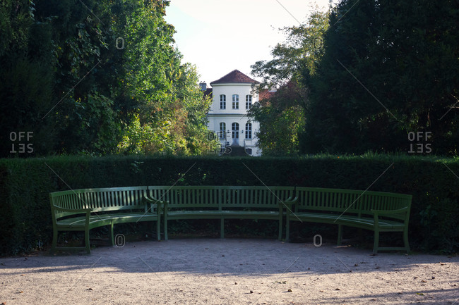 Curved bench outside a house in Sanssouci Park, Potsdam, Germany