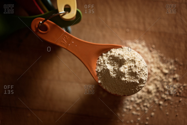 Close-up of bean flour, or chickpea flour, in a measuring cup
