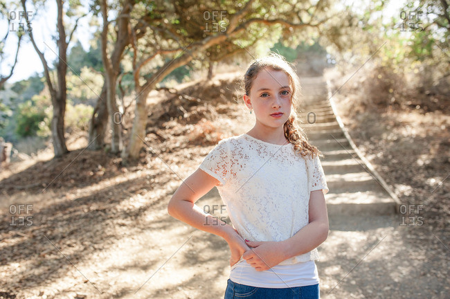 Portrait of a young girl standing at the bottom of a natural staircase