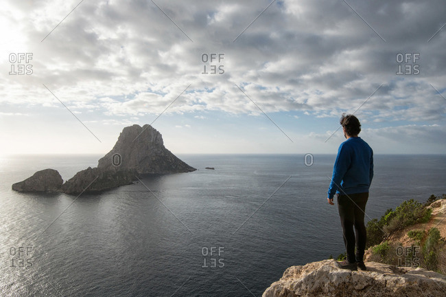 Man gazing at Es Vedra from mountains in Ibiza