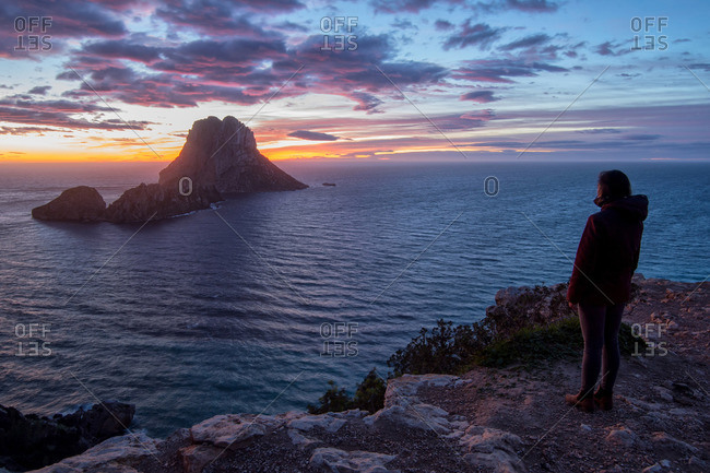 Young woman looking on the sunset in Ibiza